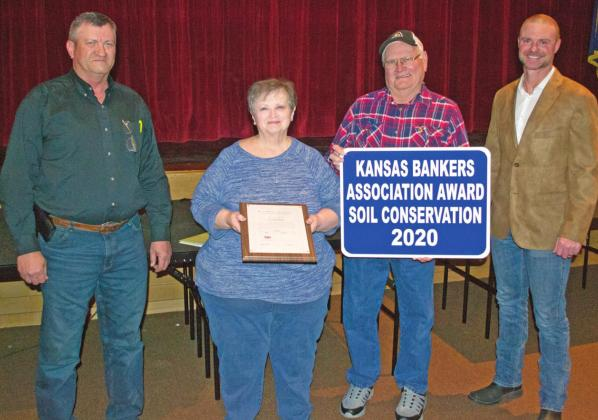 The annual Kansas Bankers Association Conservation award was presented to Pat and Joe Carlson recognizing their efforts to conserve water and soil on their 160 acre family farm. The Carlson's farm has been in their family for 160 years.